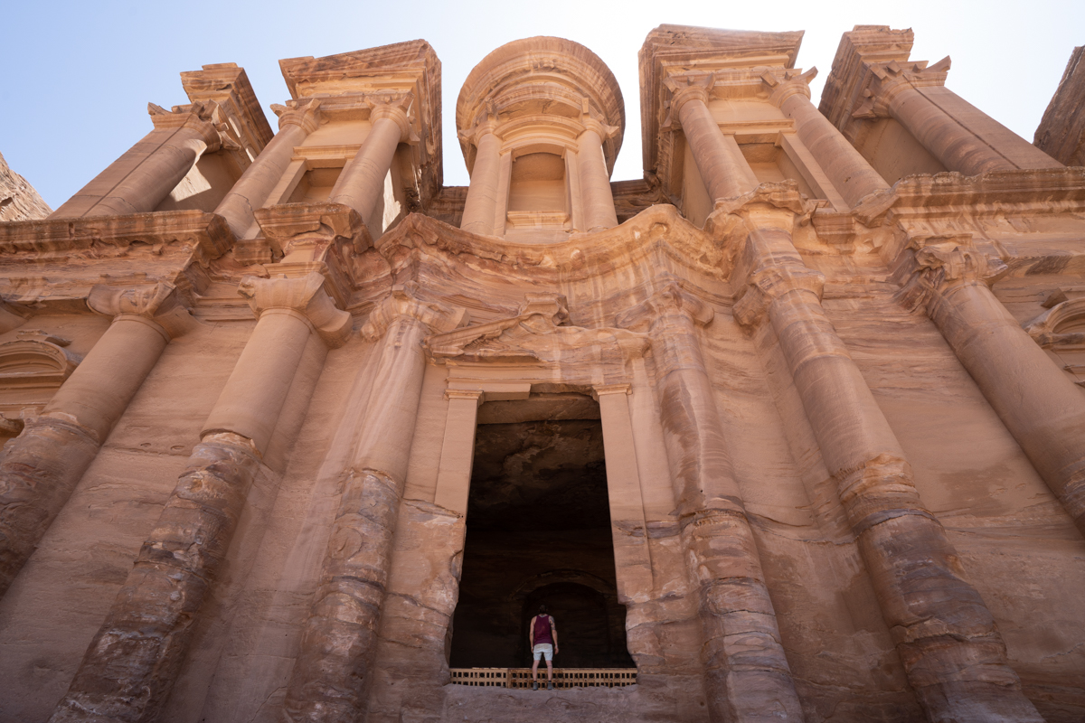Tourist in front of he Monastery in Petra