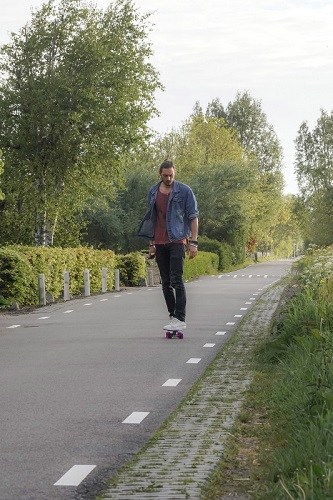 a man skating on his own on a flat road