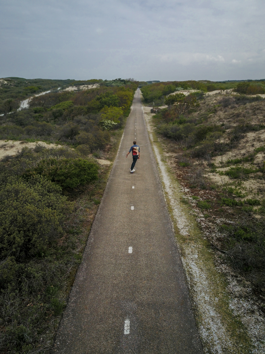 Isolated skater boy on remote road