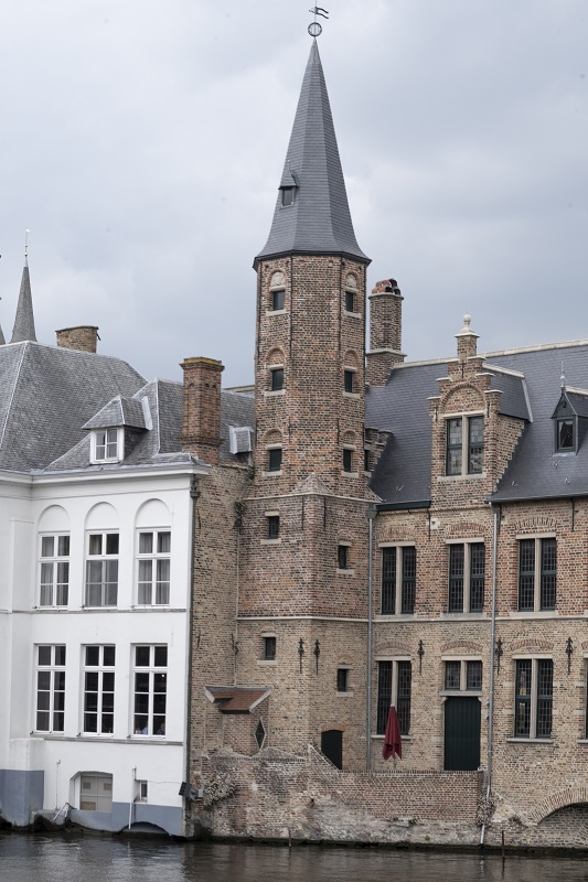 Bruges monument by the canal in Belgium