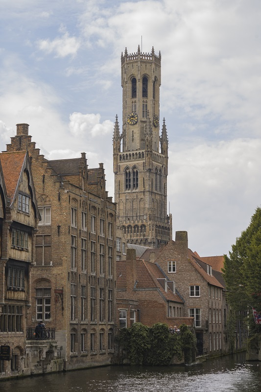 Bruges church by the canal in Belgium