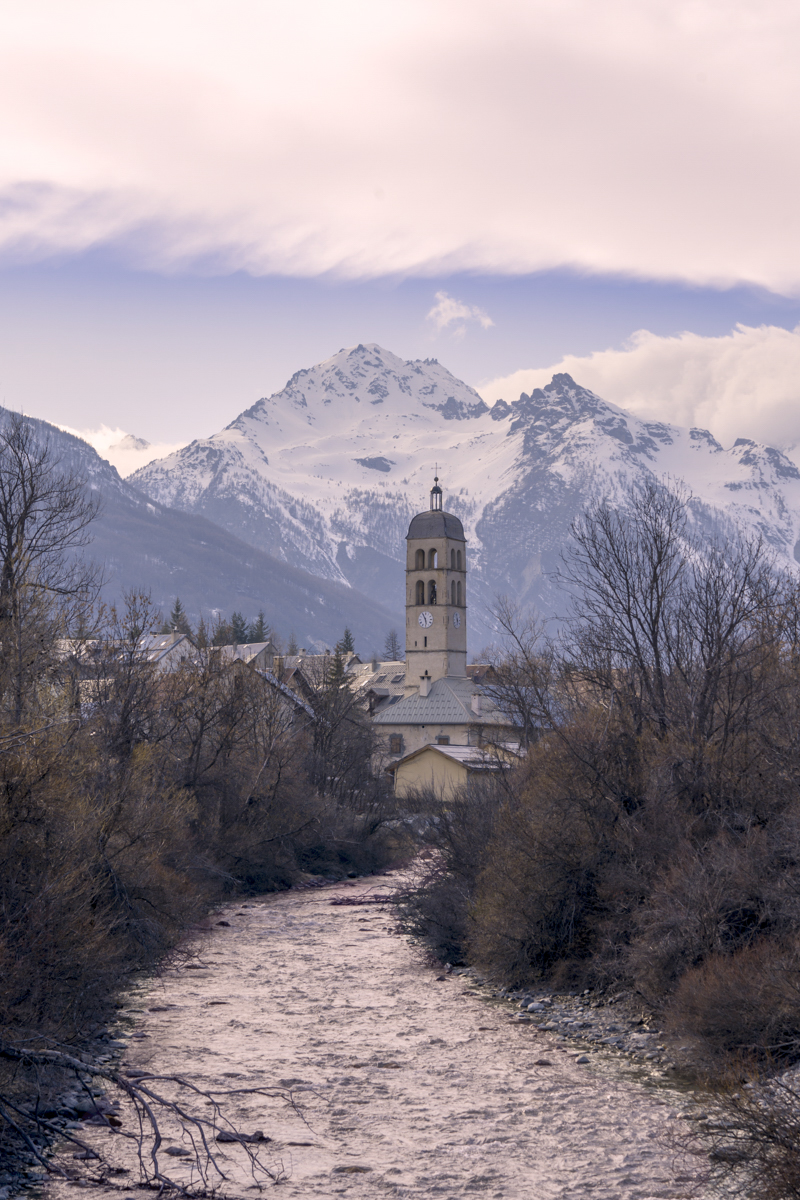 Church in front of the Alps Mountains at sunrise