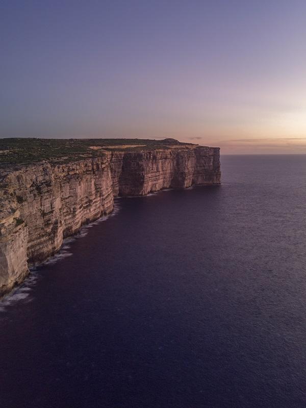 Maltese cliff at sunsert overlooking Mditerranean sea