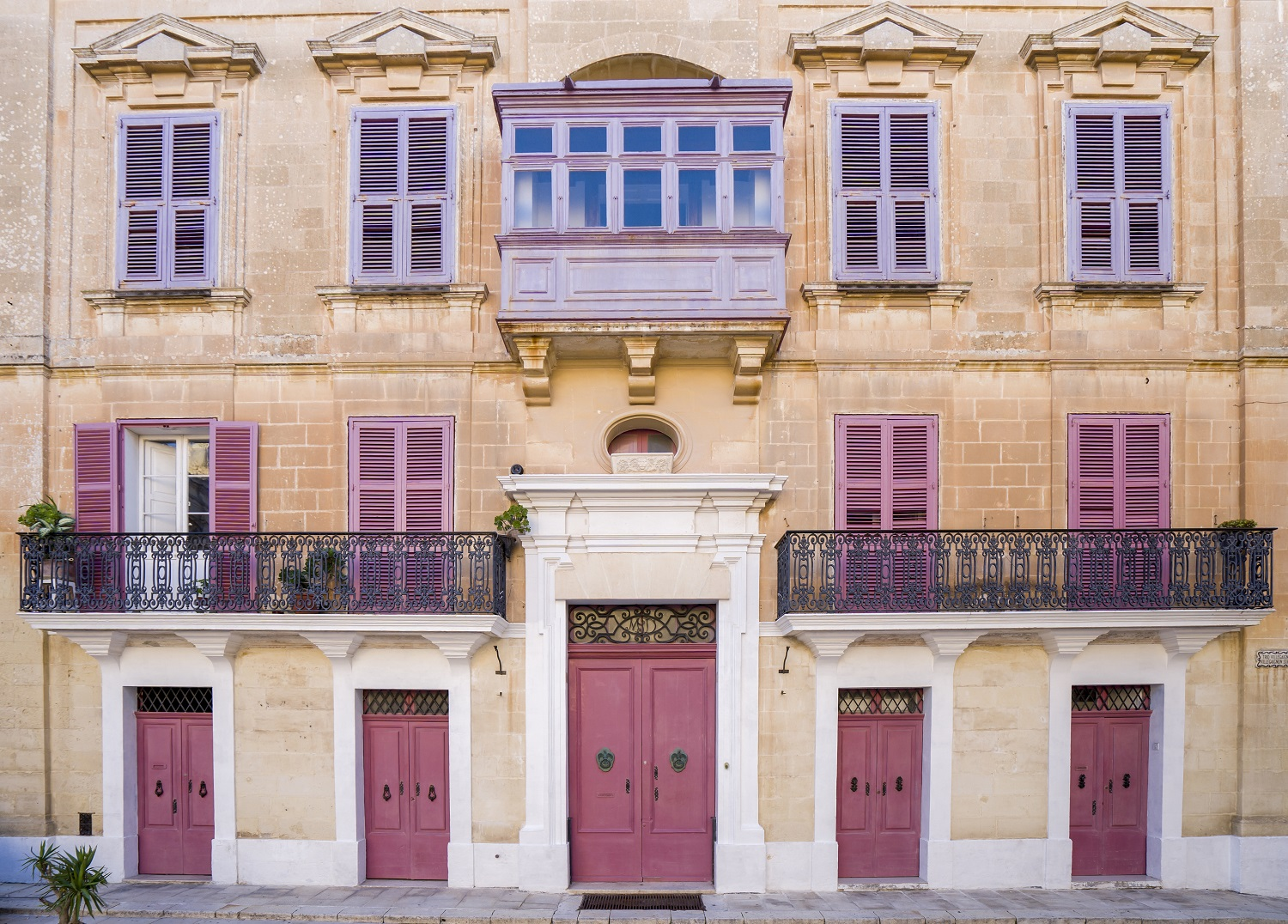 Colorful door Facade In Malta, typical stone wall and Maltese architecture