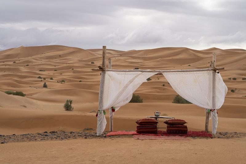 A sitting area in a luxury desert camp facing the Sahara, Merzouga, Morocco, Africa