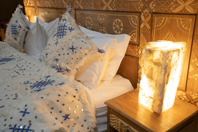 Detailed luxury Moroccan berber bedding and night stand decoration