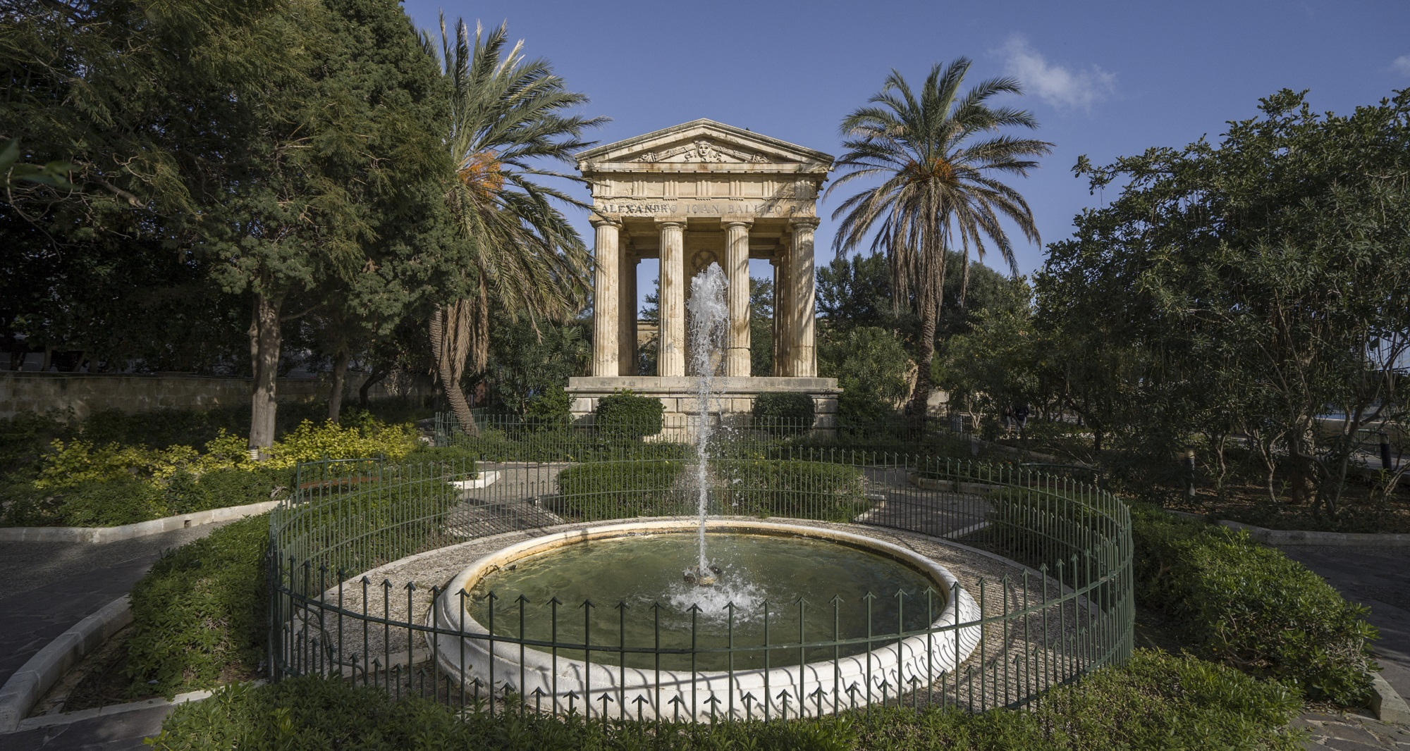 malta Greek Style Temple Portico surrounded by Palm Trees & Decorative Fountain