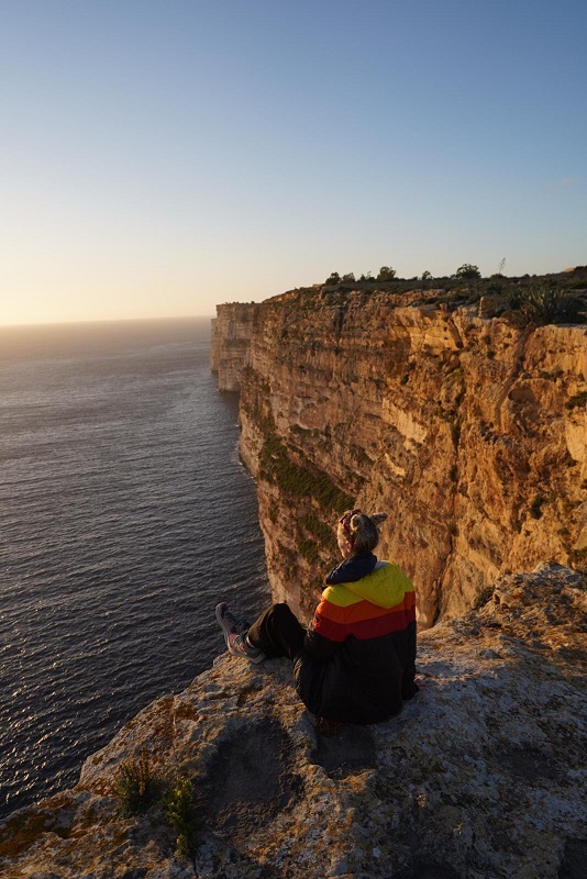Man on the edge of a cliff above the sea (1)