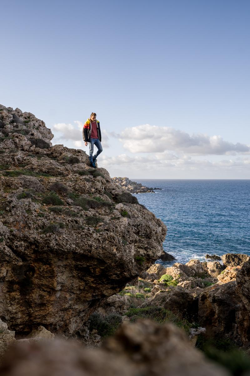 man near cliff in Malta by the sea