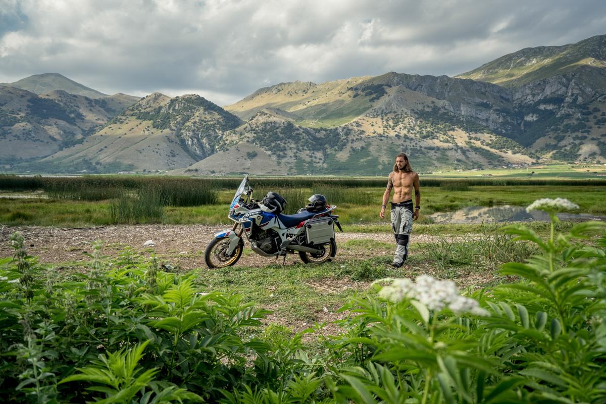 Man and Africa Twin Honda motorbike