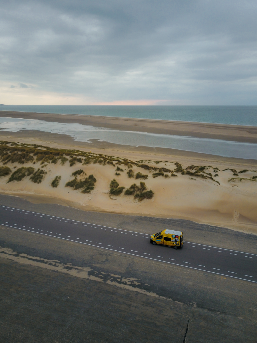 Drone shot of a Camper van by the North Sea