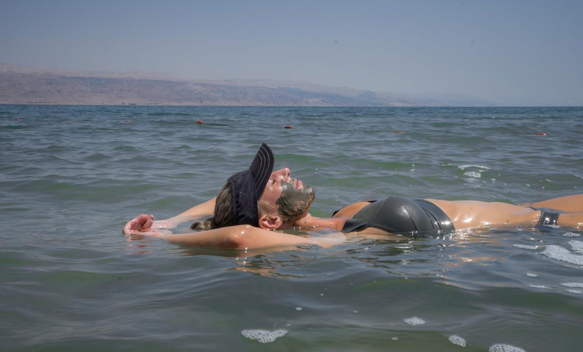 Woman in bikini floating in Dead Sea