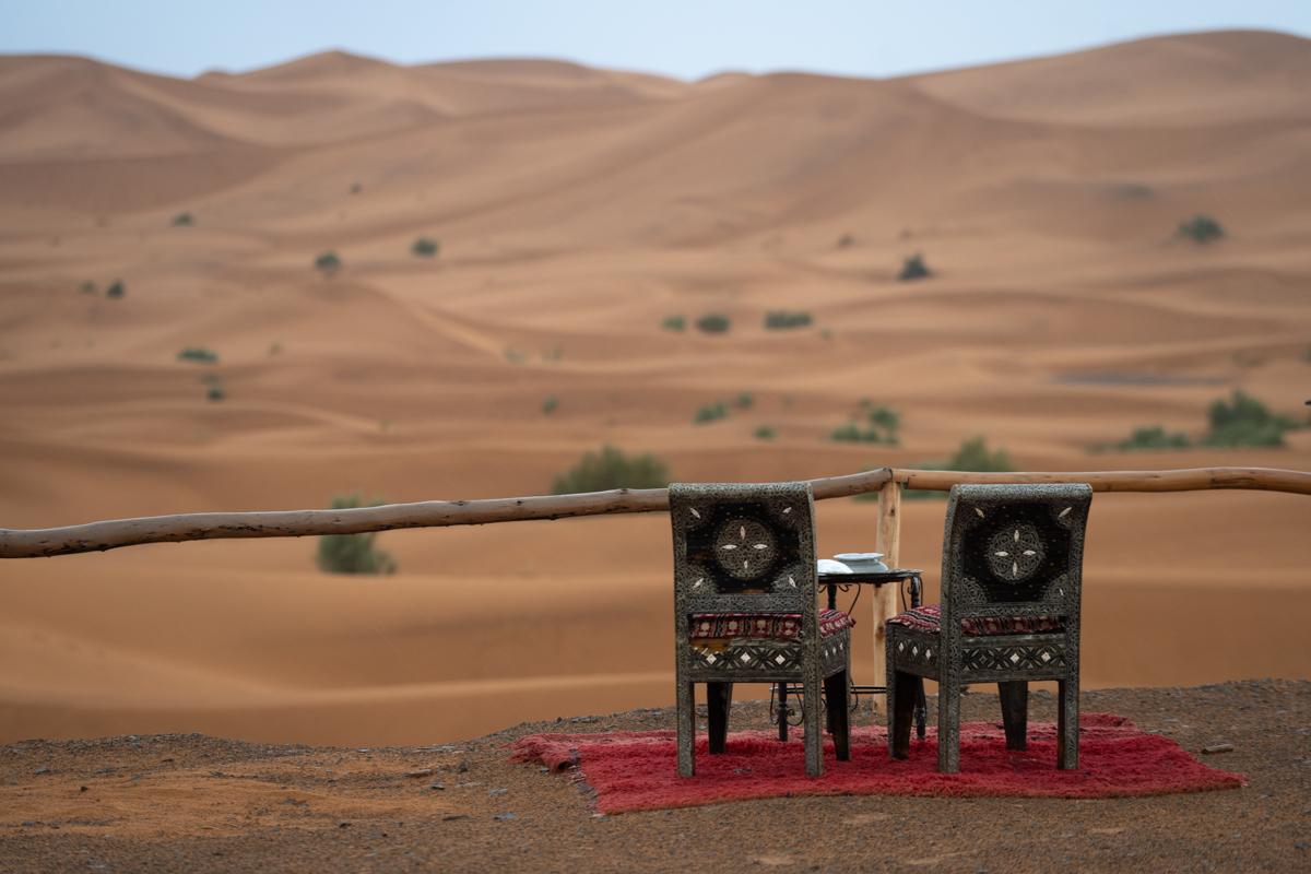 African chair facing the Sahara desert dunes